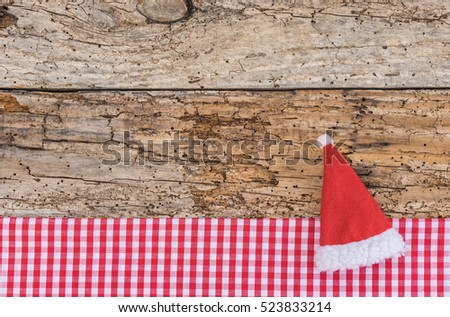 Advent background decoration with Santa hat, as gift card, voucher or greeting card at Christmas.