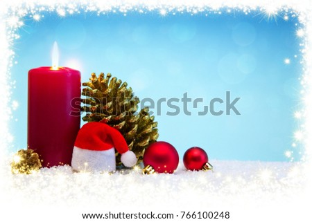 Advent candle and Santa Claus hat.Snow frame.