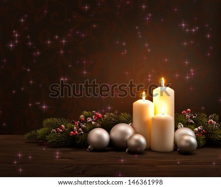 Advent Christmas wreath in front of dark moody background  - stock photo