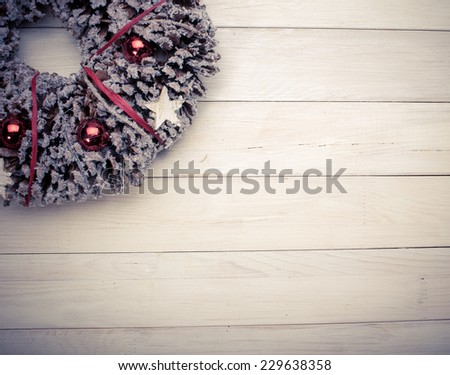 Advent Christmas wreath on wooden background  - stock photo