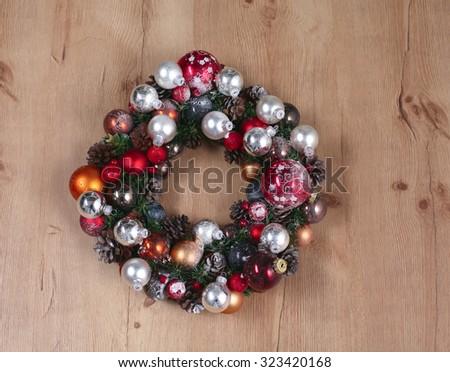 Advent Christmas wreath on wooden door decoration - stock photo