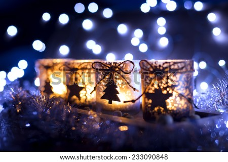 Advent, four candles decorated Christmas tree on a background of lights - stock photo