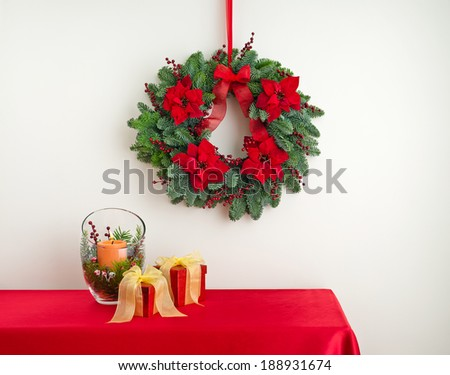 Advent wreath over side board with gifts