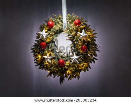 Advent wreath over silver grey background Christmas lights - stock photo