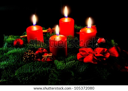 Advent wreath with candle and decorations - stock photo