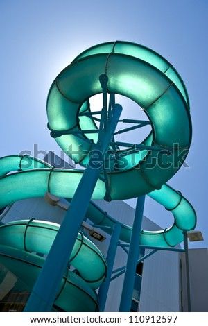 Adventerous water slide against a summer blue sky.