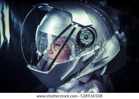 Adventure, Boy playing to be an astronaut with space helmet and metal suit