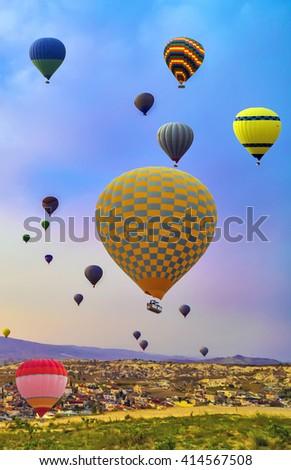 adventure Hot Air balloons flying over Mountains landscape sunset Cappadocia, Turkey - stock photo
