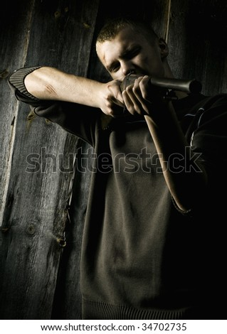 Adventure hunter with gun - stock photo