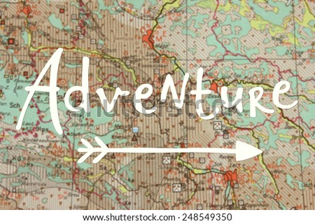 Adventure written on blurred map - stock photo