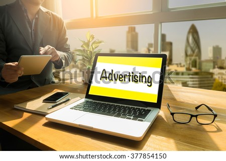 Advertise Advertising Advertisement Branding Concept, Thoughtful male person looking to the digital tablet screen, laptop screen,Silhouette and filter sun - stock photo