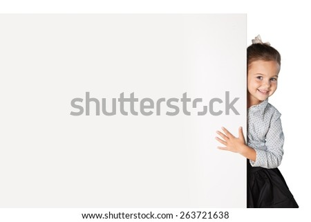 Advertise. Cute child behind a white board - stock photo