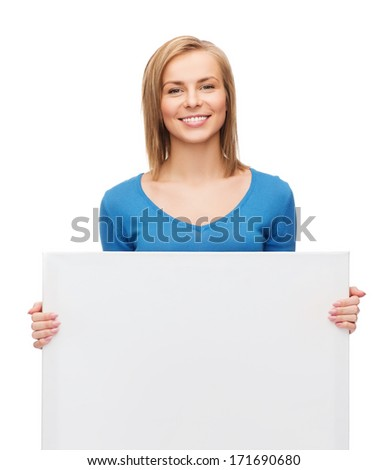 advertisement and people concept - smiling girl with blank white board - stock photo