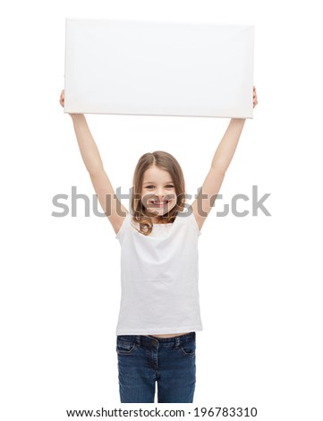 advertisement, art, children, happiness and painting concept - smiling little child in white blank t-shirt holding blank white board - stock photo