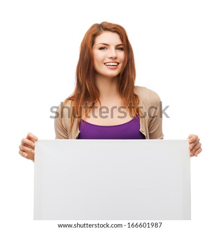 advertisement, sale and people concept - smiling young girl with blank white board