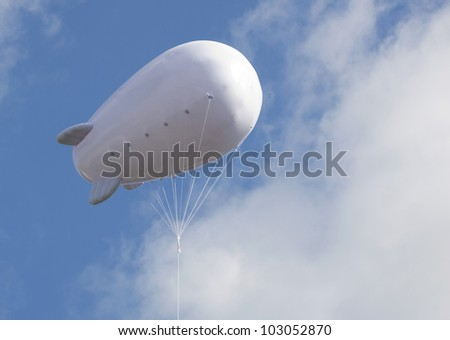 Advertising balloon with free space high in the sky - stock photo