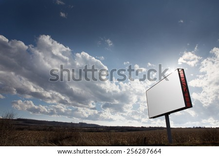 Advertising blank billboard and cloudy sky background - stock photo