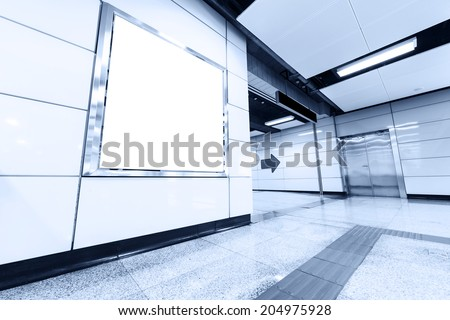 advertising board in metro station - stock photo
