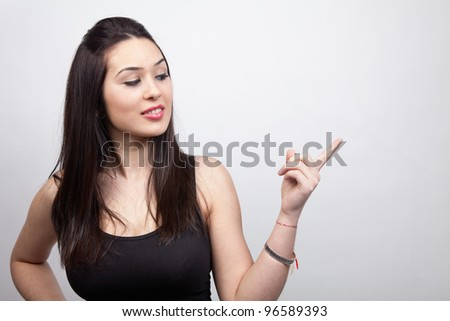Advertising concept - cute young woman showing something