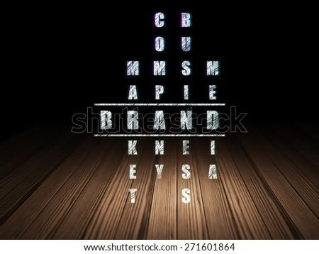 Advertising concept: Glowing word Brand in solving Crossword Puzzle in grunge dark room with Wooden Floor, black background, 3d render - stock photo