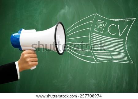 advertising CV document through a megaphone  - stock photo