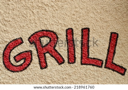 "Advertising inscription ""Grill"" on the grey wall"