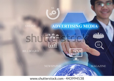ADVERTISING MEDIA  concept presented by  businessman touching on  virtual  screen -image element furnished by NASA- SOFT SILVER TONE - stock photo