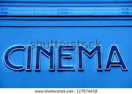 Advertising neon sign on a wall/Cinema - stock photo