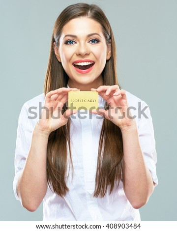 Advertising of payment systems with beautiful woman holding credit bank card. Isolated portrait of smiling  female model. - stock photo