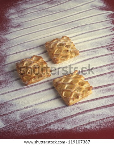 advertising photography with bakery products, sweet grid cake pieces isolated on flour background with hand drawn lines