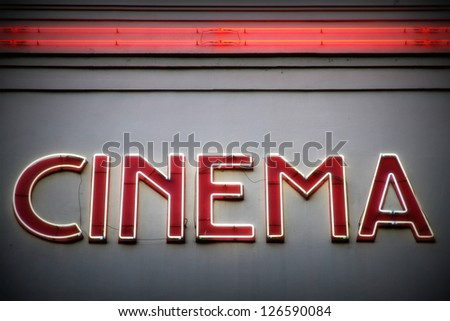 Advertising red neon sign on a wall/Cinema - stock photo
