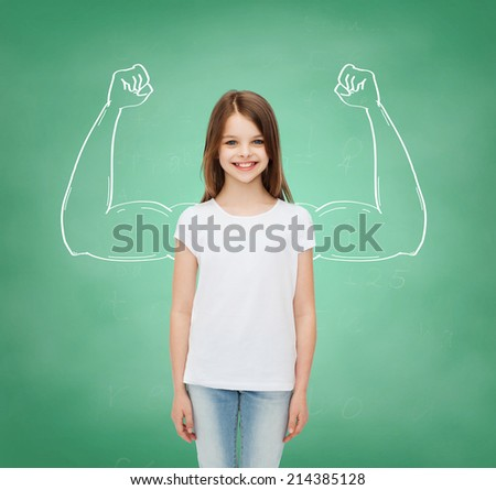 advertising, school, education, childhood and people - smiling little girl in white blank t-shirt over green board background with strong arms drawing - stock photo
