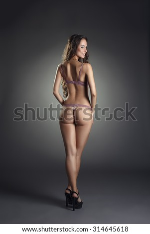 Advertising underwear. Rear view of smiling model - stock photo