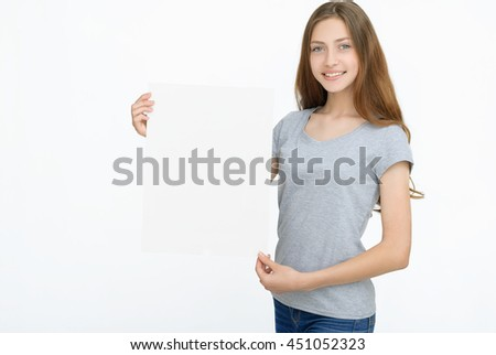 Advertising. Young smiling woman show blank card or paper on white background.