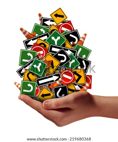 Advice help support concept as a human hand holding a group of confusing traffic road signs and street cones as a metaphor for helping with career guidance or business and life pathway. - stock photo