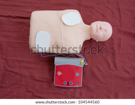 AED used in CPR training - stock photo