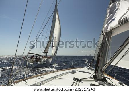 "AEGEAN SEA, GREECE - APR 29, 2014: Unidentified sailors participate in sailing regatta ""11th Ellada 2014"" on Aegean Sea.  - stock photo"