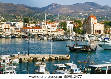 Aegina, Greece - October 15, 2016: Street view of the seafront and the harbour of Aegina town, Greece