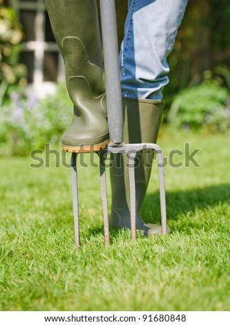Aerating lawn - stock photo