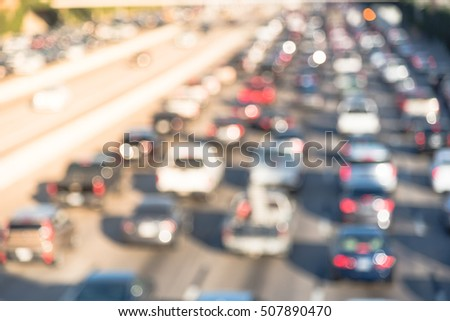 Aerial blurred image of traffic along Interstate Highway 69 in afternoon rush hour at downtown Houston, Texas, US. High-occupancy vehicle lane used at peak travel times.  Urban infrastructure problem.