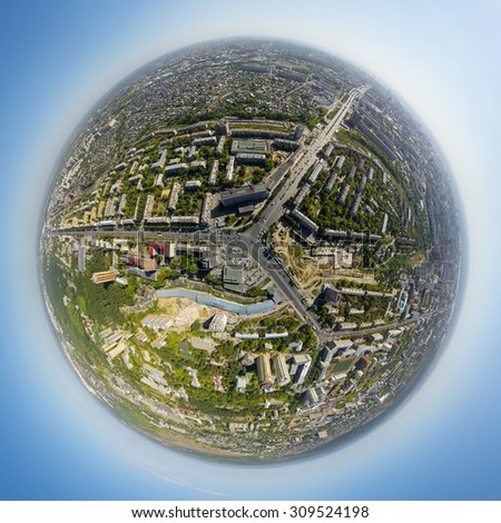 Aerial city view with crossroads and roads, houses, buildings, parks and parking lots, bridges. Copter shot. Little planet sphere mode. - stock photo