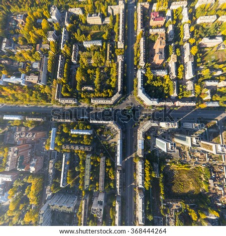 Aerial city view with crossroads, roads, houses, buildings and parks . - stock photo