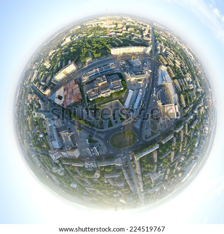 Aerial city view with crossroads, roads, houses, buildings, parks, parking lots, bridges - little planet spherical mode