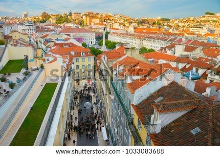 Aerial cityscape of Lisbon downtown at sunset, crowded street view, Portugal