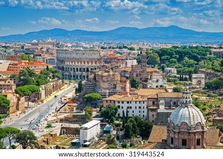Aerial cityscape of Rome with Forums and Colosseum, Rome, Italy - stock photo