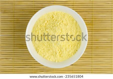 Aerial closeup of maize flour - stock photo