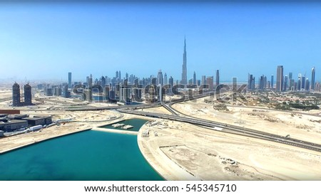 Aerial drone photo of futuristic city of Dubai, skyline from distance, United Arab Emirates