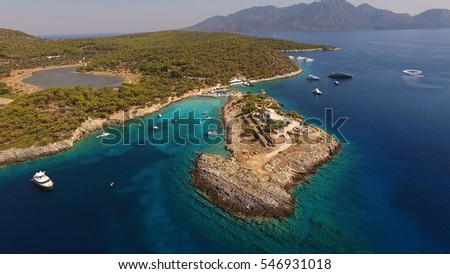 Aerial drone view of Agistri island, Aponissos beach with turquoise waters, Saronic gulf, Greece