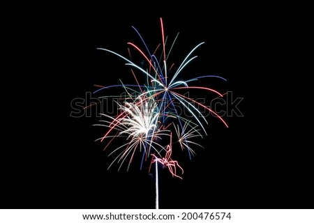 Aerial Fireworks Exploding with Red White Blue and Green Colors - stock photo