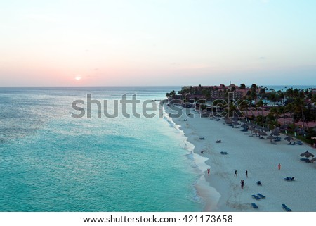 Aerial from a beautiful sunset at Manchebo beach on Aruba island in the Caribbean sea - stock photo